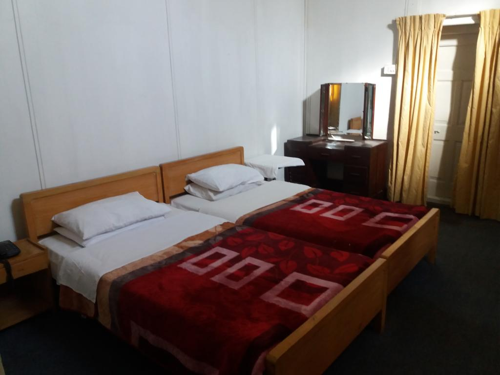 BRIGHTLANDS-HOTEL-twin-bed
